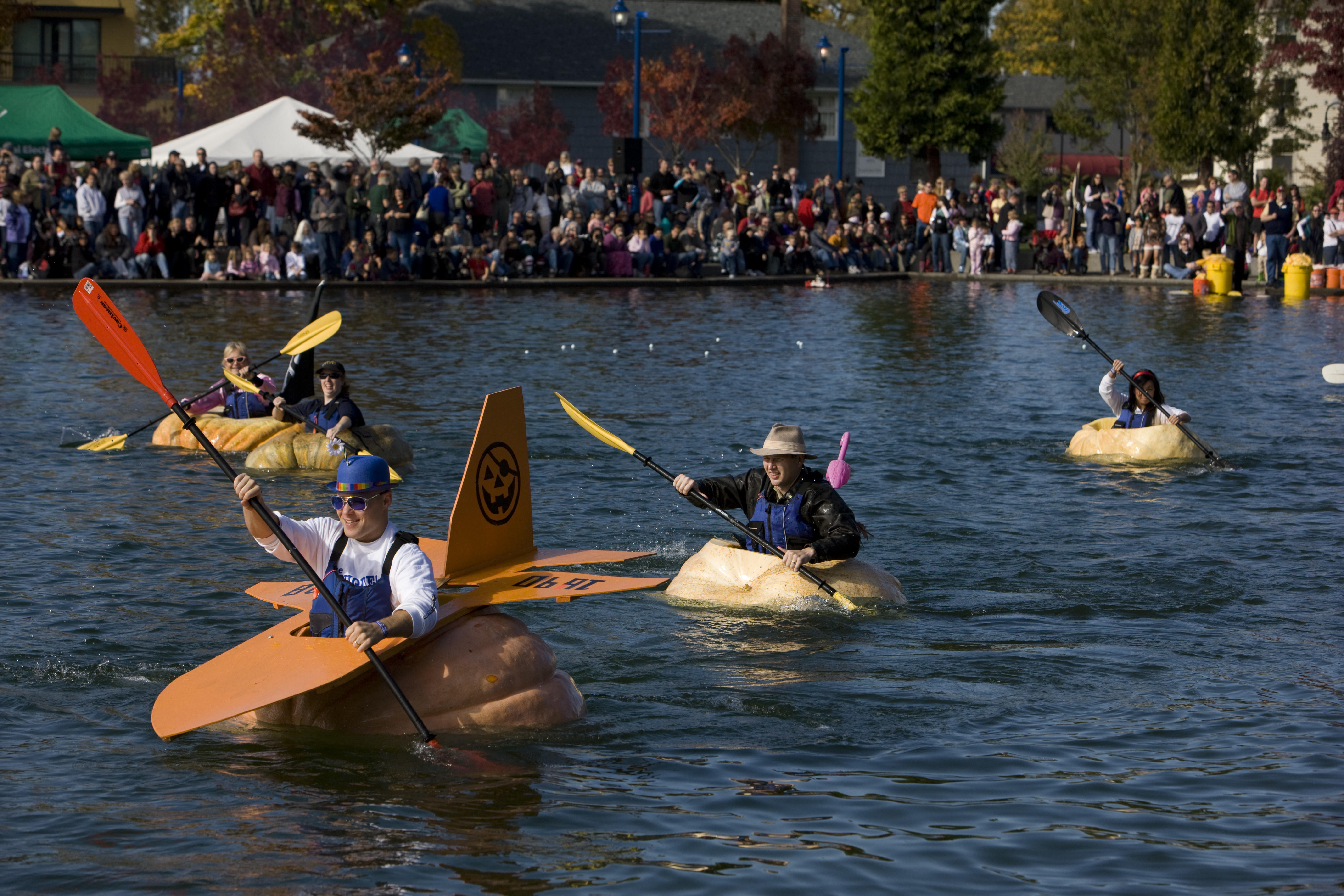 25 Oct 2008, Tualatin, Oregon, USA --- 25 October 2008: 5th Annual West Coast Giant Pumpkin Regatta at Tualatin Commons in Tualatin, Ore. Locally-grown pumpkins weighing up to 800 pounds are hollowed-out and serve as vessels for a boat race around the lake. --- Image by © Sol Neelman/Corbis
