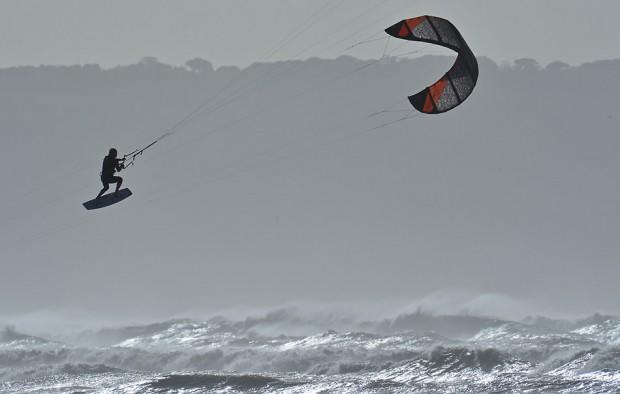 A kitesurfer gets 'big air' whilst competing in the British Kitesports Championships at Westward Ho! in north Devon, south west England October 17, 2012. 'Big air' is a term referring to a large jump utilising wind, kite, board speed and the lip of the wave. The competition lasts until October 20. REUTERS/Toby Melville (BRITAIN - Tags: SOCIETY SPORT)