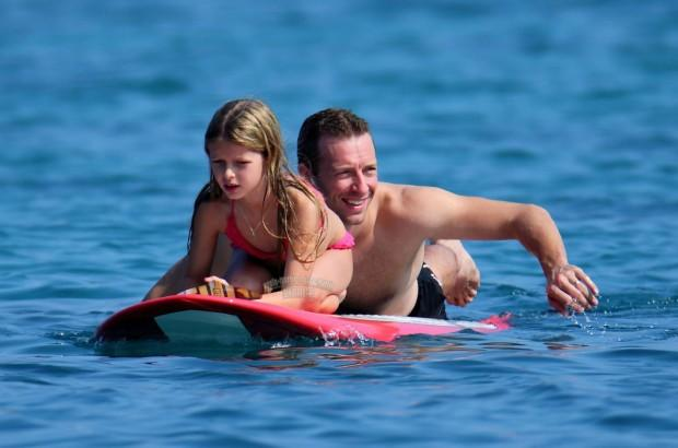 "Exclusive... 51295542 ""Iron Man 3"" star Gwyneth Paltrow shows off her bikini body as she enjoys a day at the beach with her family on New Year's Eve in Hawaii on December 31, 2013. Gwyneth and her husband Chris Martin played with their kids Apple and Moses in the warm Hawaiian waters before laying out on the beach to soak up the sun! The happy couple also revealed some tattoos in on honor of each other. Chris had a small G tattooed on his arm while Gwyneth had a C near her hip. NO INTERNET USE WITHOUT PRIOR AGREEMENT ""Iron Man 3"" star Gwyneth Paltrow shows off her bikini body as she enjoys a day at the beach with her family on New Year's Eve in Hawaii on December 31, 2013. Gwyneth and her husband Chris Martin played with their kids Apple and Moses in the warm Hawaiian waters before laying out on the beach to soak up the sun! NO INTERNET USE WITHOUT PRIOR AGREEMENT FameFlynet, Inc - Beverly Hills, CA, USA - +1 (818) 307-4813"