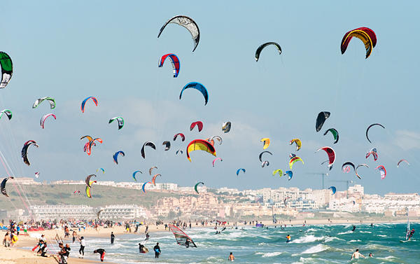 Kite Surfing On Dos Mares Beach In Front Of Hotel Dos Mares; Tarifa, Costa De La Luz, Andalusia, Spain --- Image by © Ben Welsh/*/Design Pics/Corbis