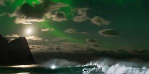 Mick Fanning surfs under the northern lights Lofoten, Norway on November 10, 2016