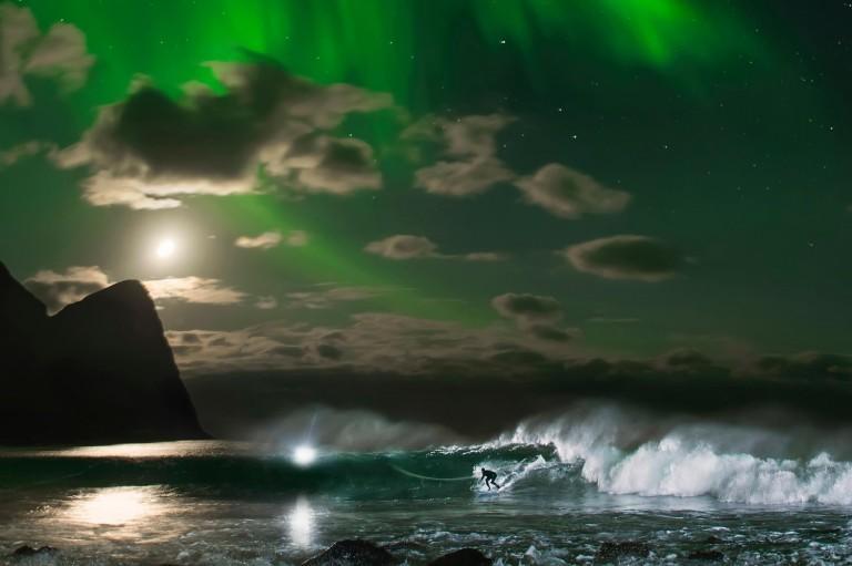Mick Fanning surfs under the northern lights Lofoten, Norway on November 10, 2016